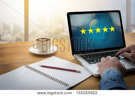Businessman holding five star ratingReview increase rating or ranking evaluation and classification concept stock photo