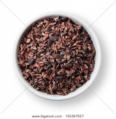White bowl of cacao nibs isolated on white background stock photo