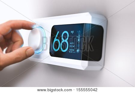 Hand turning a home thermostat knob to set temperature on energy saving mode. fahrenheit units. Composite image between a photography and a 3D background.