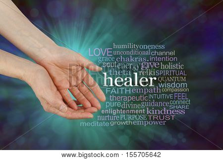 Healer Offering Healing Word Cloud - female hands in open giving gesture beside a HEALER word cloud on a green and blue outwardly flowing bokeh background stock photo