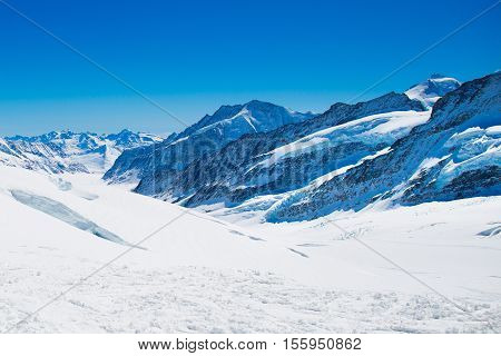 Aerial view of the Alps mountains in Switzerland. View from helicopter in Swiss Alps. Mountain tops in snow. Breathtaking view of Jungfraujoch and the UNESCO World Heritage - the Aletsch Glacier stock photo
