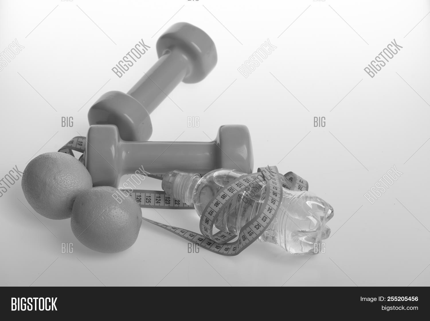 aerobics,athletic,background,barbell,bottle,citrus,color,concept,copy,diet,dieting,dumbbell,equipment,exercise,fit,fitness,flexible,fruit,green,gym,health,healthy,juicy,length,lifestyle,liquid,loss,measure,measurement,metering,nutrition,orange,plastic,refresh,regime,shape,slim,space,sport,sportive,tape,training,water,weight,white