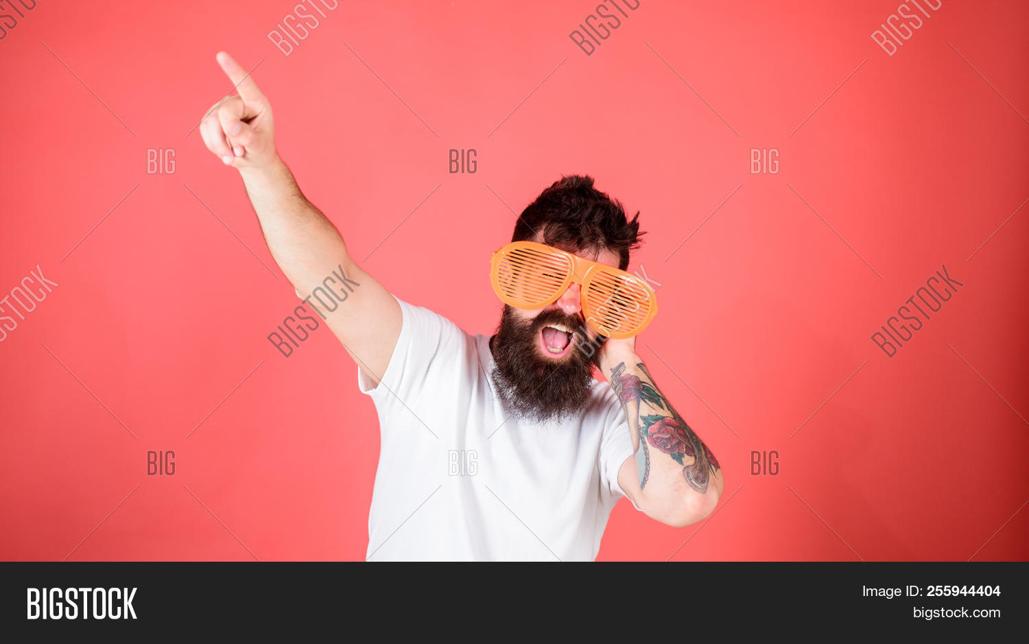Man bearded hipster dj wears giant louvered sunglasses. Sunglasses accessory gives incredible feeling of confidence. Feel like superstar in that eyeglasses. Hipster dj wears shutter shades sunglasses.