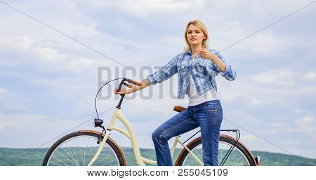 Girl ride cruiser bicycle. Woman rides bicycle sky background. Reasons to ride bike. Benefits of cycling every day. Keep fit shape easy with regular cycling. Health benefits of regular cycling. stock photo
