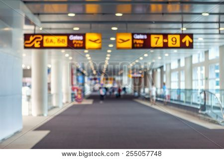 Traveling Concept. Travelers Walking With A Luggage At Airport Terminal Blurred Crowd Of Travelling