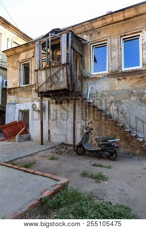 A colorful landscape of ruined houses in a poor neighborhood for poor people. Construction of a poor state. , Architecture of the poor neighborhood. An old house in the area of smells stock photo