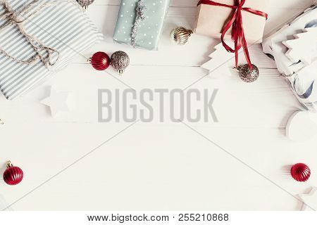 christmas flat lay. modern christmas layout with ornaments and gift boxes, top view with space for text. holiday mockup greeting card. stylish winter flatlay stock photo