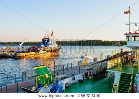 Dry cargo carrier in the Port of Klaipeda in Lithuania, Eastern European country on the Baltic sea. At romantic sunset stock photo