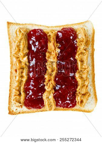 close up of american peanut butter and jelly sandwich isolated stock photo
