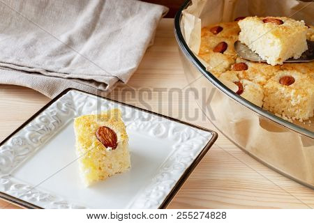 Pieces Basbousa or Namoora traditional arabic sweet dessert with almond. Homemade semolina cake. Selective focus. stock photo
