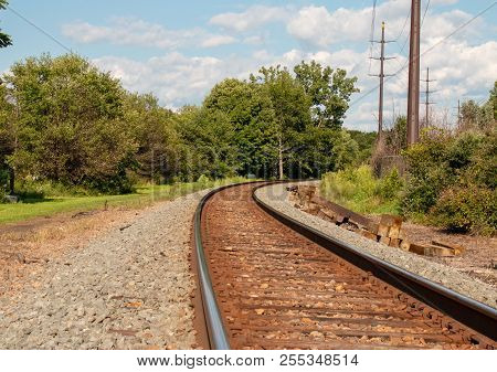 the railroad in the country with green trees. stock photo