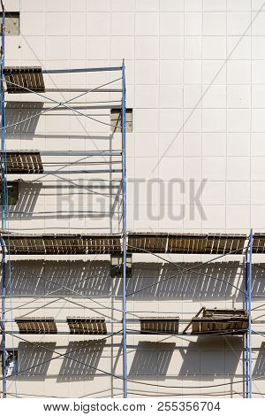 Closeup of scaffolding used as a temporary structure to support the structure of a building during construction. Scaffolding used as a working platform for workers. stock photo
