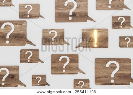 White question and exclamation marks on wooden speech bubbles over gray background. Shining exclamation mark. FAQ concept and looking for an answer. 3d rendering stock photo