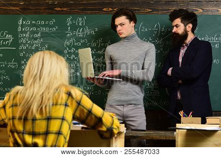 University studying friends studying and reading a books in classroom. Teachers reputation is gold. Students build positive relationships with their teachers. stock photo