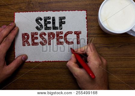 Word writing text Self Respect. Business concept for Pride and confidence in oneself Stand up for yourself Man holding marker communicating ideas piece paper wooden table cup coffee. stock photo
