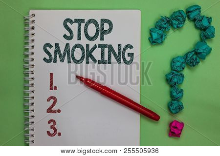 Handwriting text Stop Smoking. Concept meaning Discontinuing or stopping the use of tobacco addiction Notebook marker crumpled papers forming question mark green background. stock photo