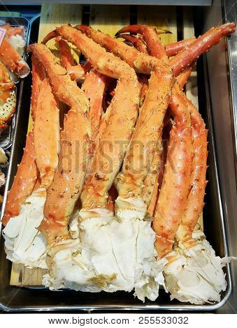 Hokkaido Steamed Crab legs sold on seafood market, Japan. stock photo