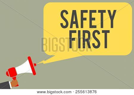 Conceptual hand writing showing Safety  Man holding megaphone loudspeaker speech bubble message speaking. stock photo