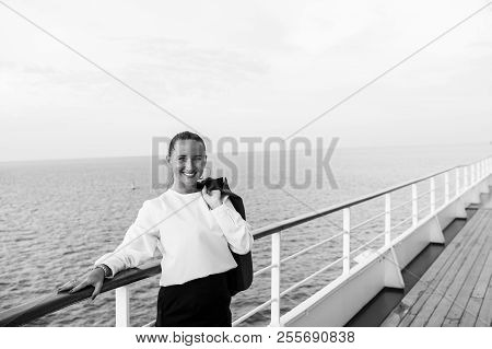 Fashion, beauty, look. Happy woman with business jacket on shipboard in miami, usa. Travelling for business. Sensual woman smile on ship board on blue sea. Wanderlust, adventure, discovery, journey. stock photo