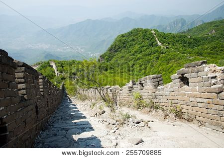 Unrestored Mutianyu Section of the Great Wall of China stock photo