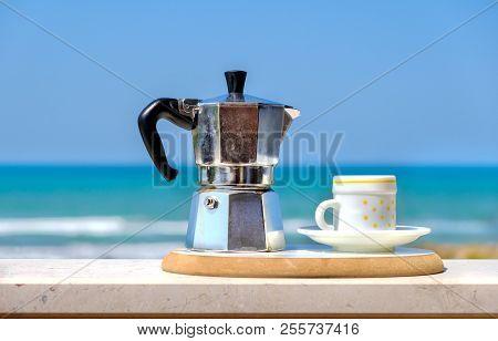 moka pot coffee maker sea background italian breakfast stock photo
