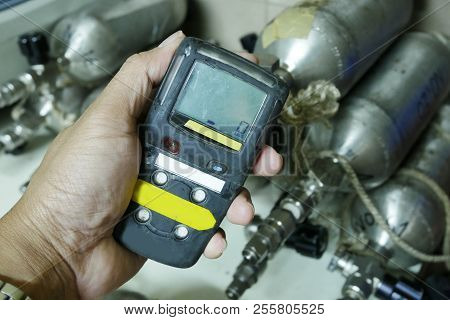Personal H2S Gas Detector,Check gas leak. Safety concept of safety and security system on offshore oil and gas processing platform, hand hold gas detector for check hydrocarbon leak to protect fire and explosion. stock photo