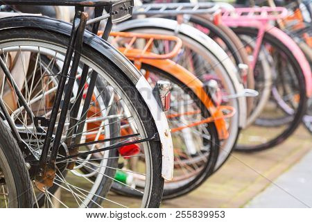 Bicycle parking lot in the city street of Amsterdam, Netherlands. Iconic transport in Amsterdam. stock photo
