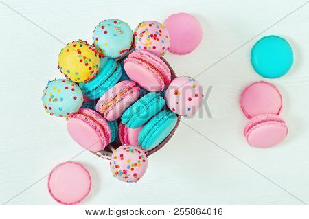 Multicolored macaroons and cake pops close up. Sweet dessert for party. Bright sweet dessert for party or holiday. Assorted cookies. stock photo