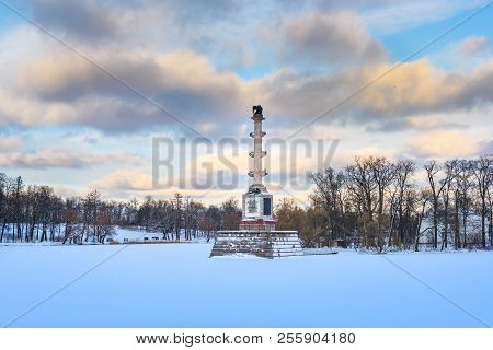 Chesme Column on frozen big pond in Catherine park at Tsarskoe Selo in winter. Pushkin town. Saint Petersburg. Russia stock photo
