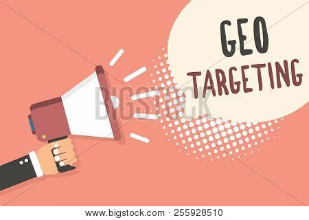 Conceptual hand writing showing Geo Targeting. Business photo showcasing Digital Ads Views IP Address Adwords Campaigns Location Man holding megaphone speech bubble pink background halftone. stock photo