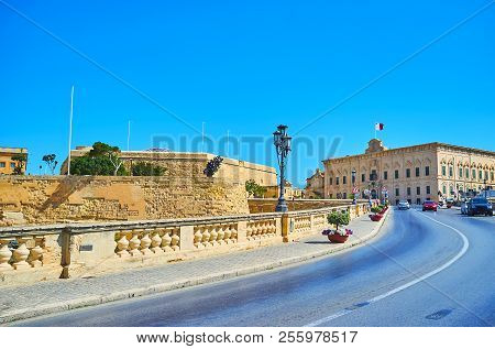 The ascent Girolamo Cassar road with a view on St James bastion from the left and Auberge Castille on the distance, Valletta, Malta. stock photo