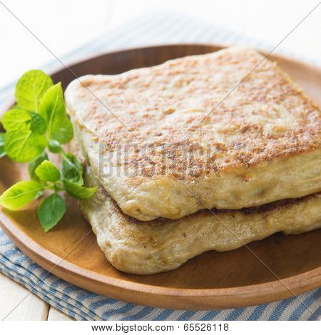 Mutabbaq or murtabak is a popular middle east stuffed bread stock photo