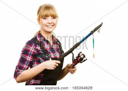 Fishing concept. Attractive woman in dungarees pink check shirt holding rod. Isolated background stock photo