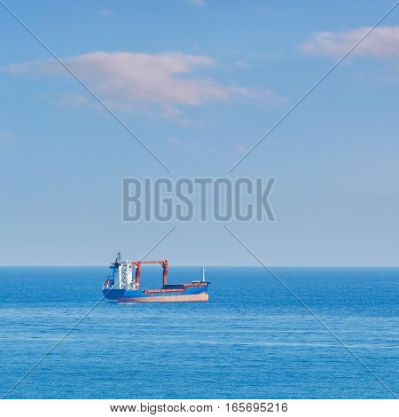General Cargo Ship in the Open Sea stock photo