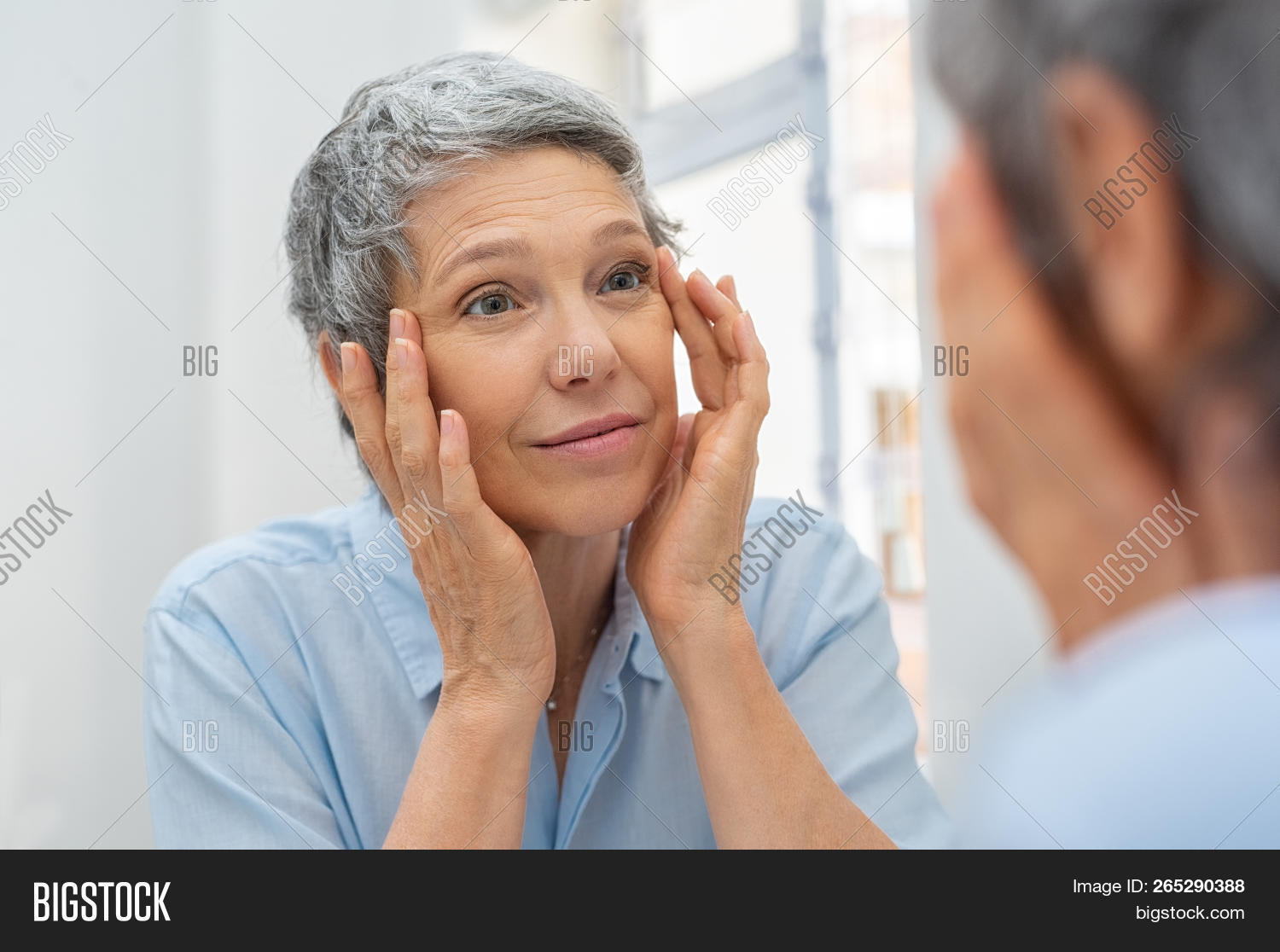 aged,aging,anti aging,applying,bathroom,bathroom mirror,beautiful,beauty,blemish,blemish face,blemished skin,care,caucasian,checking,cheerful,clean,elder,elderly,elderly woman,examining,eye,face,facial,gray hair,healthcare,healthy,lifting,looking,looking at mirror,massage,mature,middle aged woman,mirror,moisturizing,morning,old woman,routine,senior,senior woman,skin,skincare,touching,treatment,wrinkle,wrinkled,wrinkled face,wrinkled skin,wrinkles