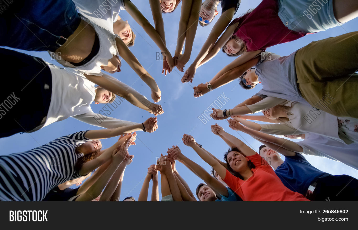 College Students Teamwork Stacking Hand Concept. Nineteen Friends.