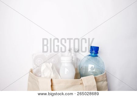 Composition with eco tissyue bag, paper, used box for eggs, packages, plastic, glass, prepared for recycling. Reduce, Reuse and Recycle concept. Flat lay, view from above, copy space stock photo