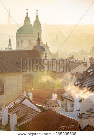 st Nicholas cathedral, Petrin hill at sunrise, Lesser Town (UNESCO), Prague, Czech republic stock photo