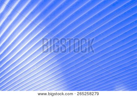 Background of vertical geometrical parallel stripes of snow colored with light shade stock photo