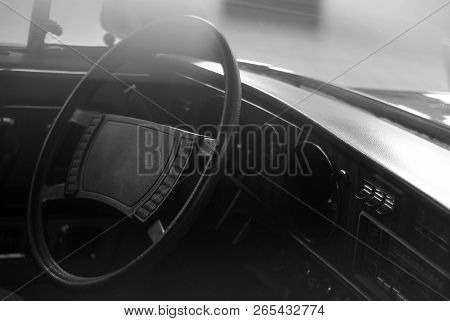 Blurred background - interior of a vintage car, styled as an old monochrome photo with dust and scratches stock photo