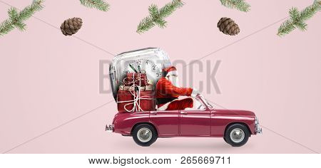 Christmas countdown arriving. Santa Claus on car delivering New Year gifts and clock at pink background stock photo