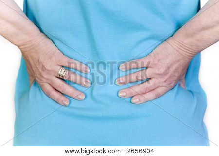 Lower back pain with close up view of hands stock photo