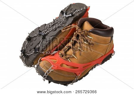 iron spikes on boots for walking on ice, lining on shoes for winter walking, tread, on a white background, isolate, side view stock photo