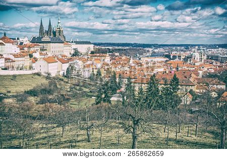 Prague city with castle from Petrin hill, Czech republic. Travel destination. Cultural heritage. Beautiful place. Old photo filter. stock photo