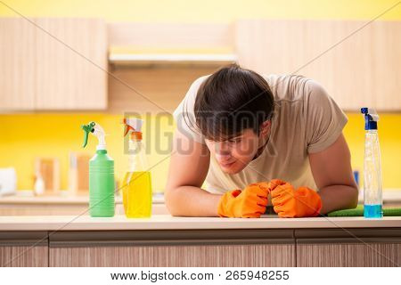Single man cleaning kitchen at home stock photo