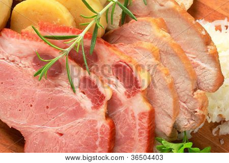 Baked pork cutlets and dumplings on a kitchen board detail stock photo