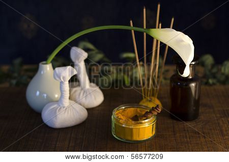 A table top arrangement of spice oil and massaging tools used in Ayurveda massage. ** Note: Slight graininess, best at smaller sizes stock photo