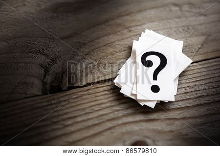 Question imprint stack on table idea for disarray, inquiry or arrangement