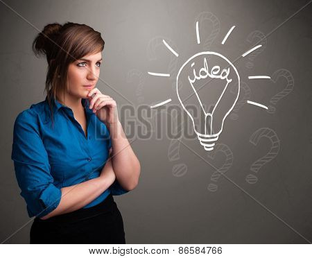 Pretty young girl comming up with a light bubl idea sign stock photo