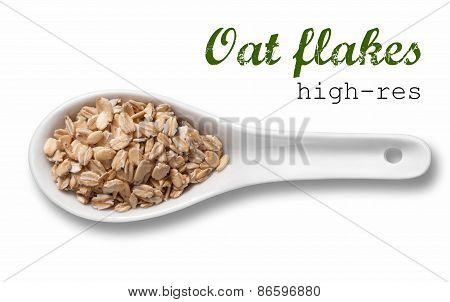 Rolled oats flakes in white porcelain spoon / high resolution product photography of seed in white porcelain spoon over white background with place for your text stock photo